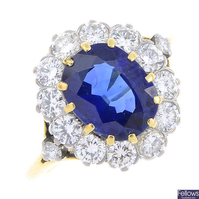 GARRARD & CO. - an 18ct gold sapphire and diamond cluster ring.