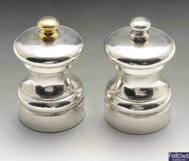 A small pair of modern silver mounted salt & pepper mills.