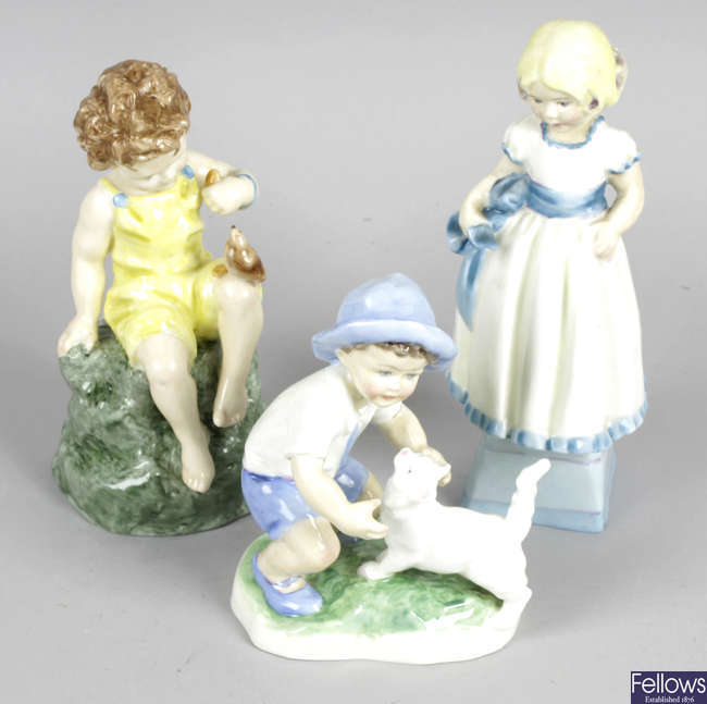 A group of twenty Royal Worcester figurines.