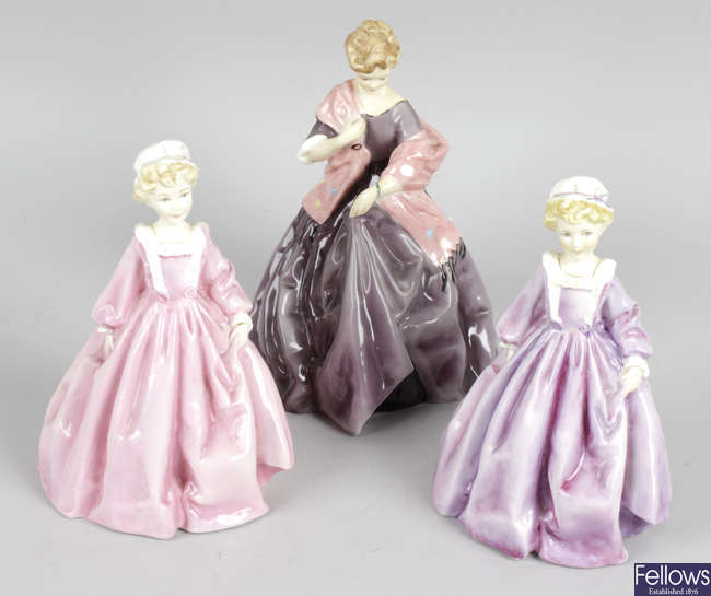 A group of seven Royal Worcester figurines.