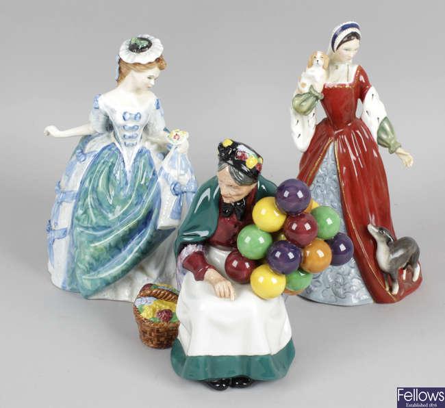 A group of twenty Royal Doulton figurines.