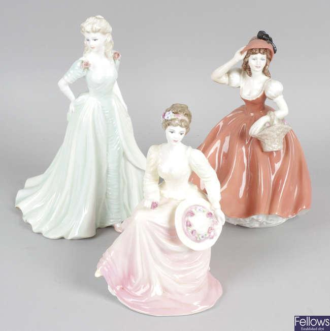 A group of twenty Coalport figurines.