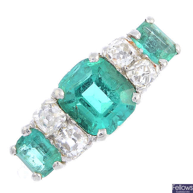 An early 20th century platinum emerald and diamond ring.