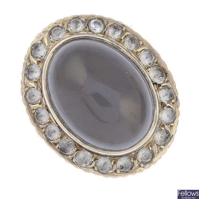 A mid 20th century moonstone and colourless gem dress ring.