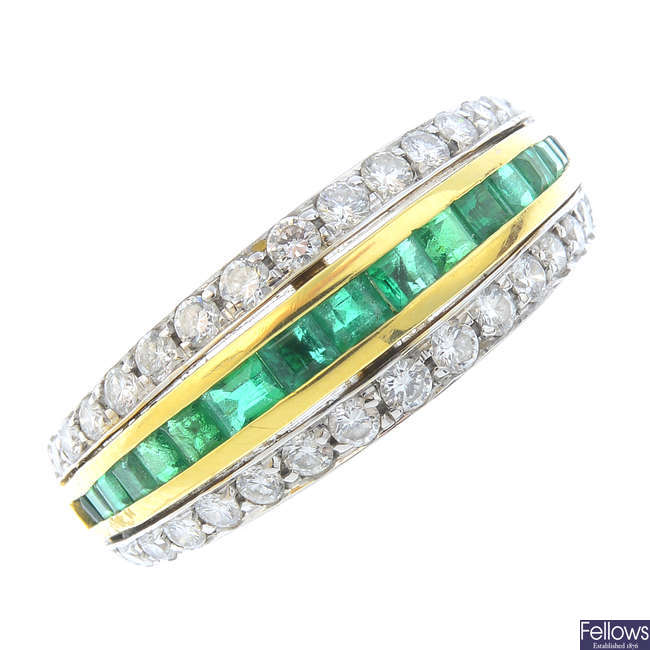 An 18ct gold gold emerald and diamond dress ring.
