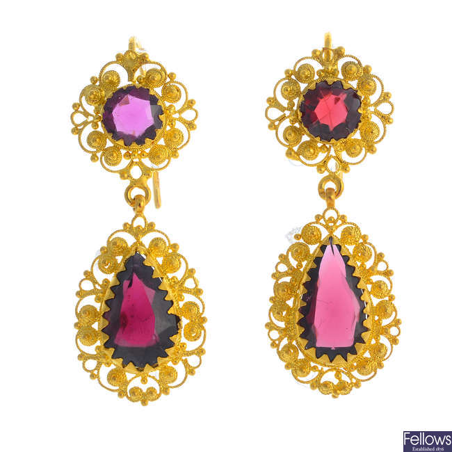 A pair of garnet earrings.