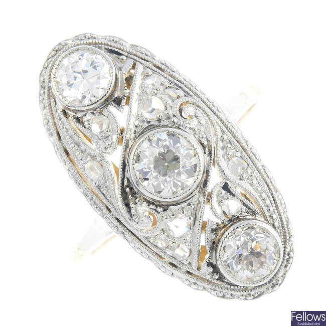 An early 20th century platinum and gold diamond dress ring.