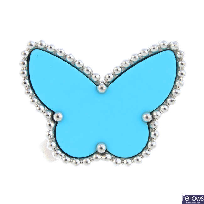 VAN CLEEF & ARPELS - an 18ct gold 'Lucky Alhambra' turquoise butterfly ring.