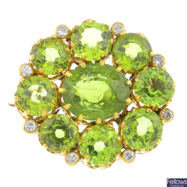 An early 20th century gold, peridot and diamond cluster brooch.