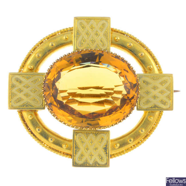 A late Victorian citrine and enamel brooch.