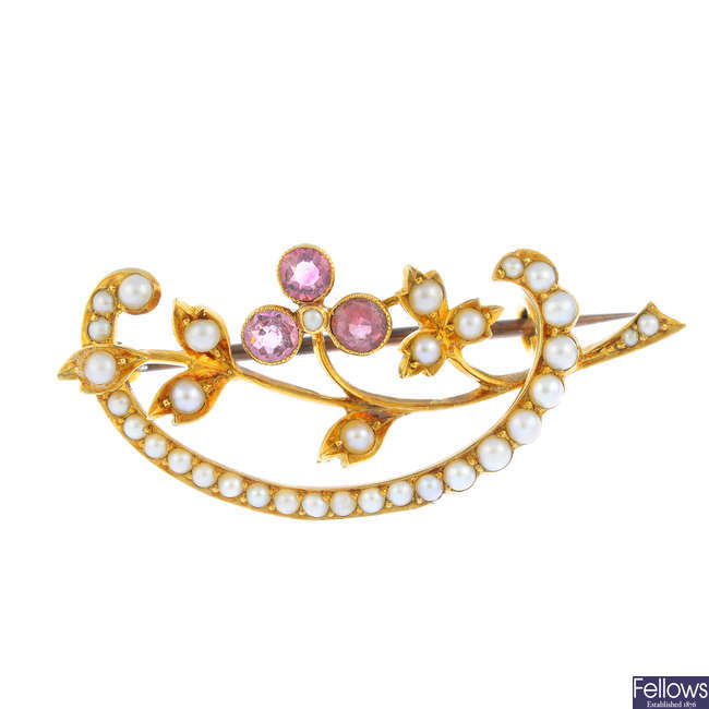 An early 20th century 15ct gold, pink sapphire and split pearl floral brooch
