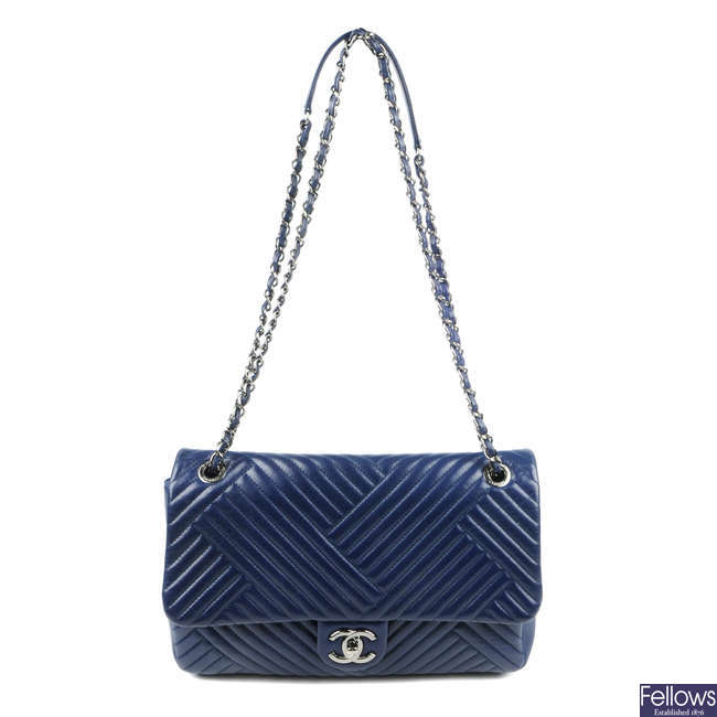 CHANEL - a blue chevron quilted Single Flap handbag.