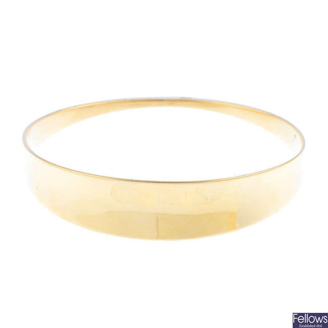 HANS HANSEN - a 14ct gold bangle.