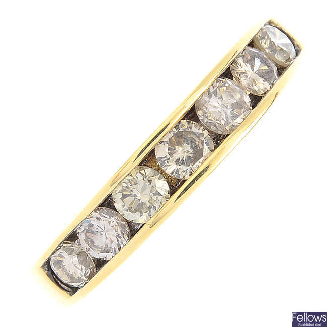 An 18ct gold diamond half eternity ring.