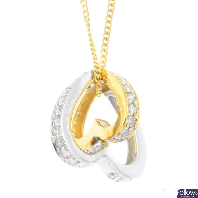 An 18ct gold diamond pendant, with 9ct gold chain.