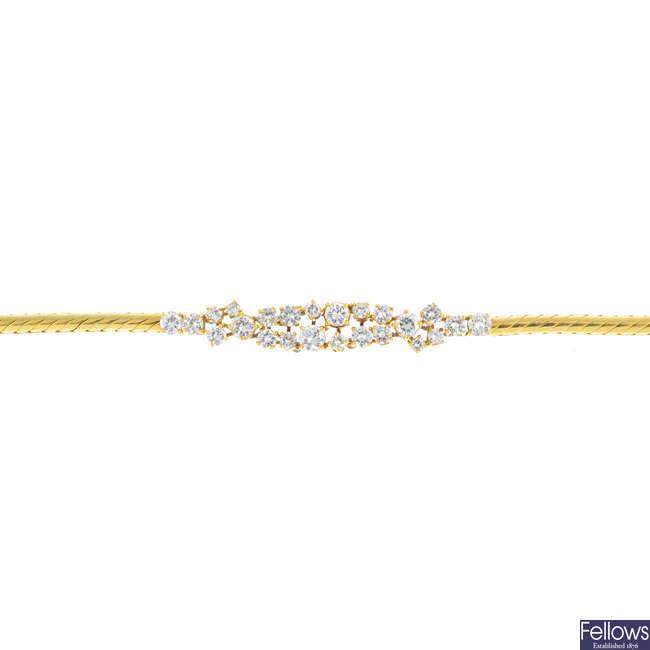 An 18ct gold diamond bracelet.