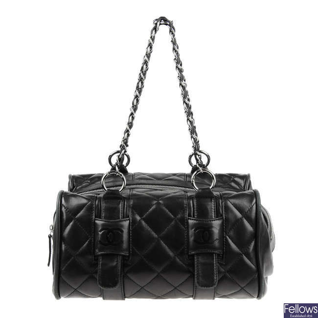 CHANEL - a small quilted duffle bag.