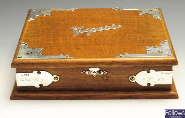 An Edwardian silver mounted table cigar box.