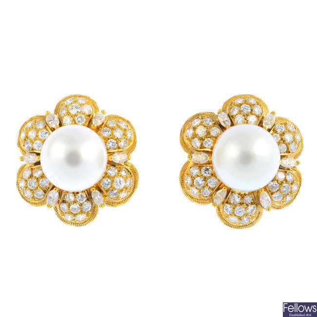 A pair of cultured pearl and diamond floral cluster earrings.