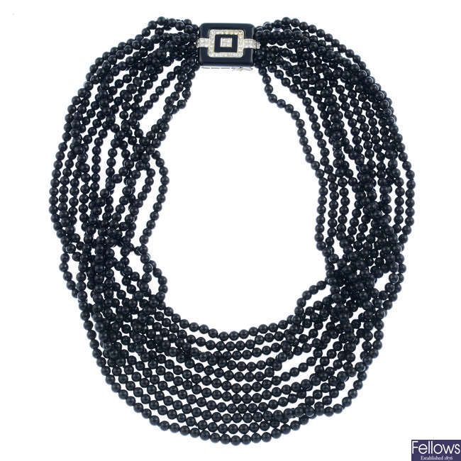 An onyx multi-strand necklace, with diamond and onyx clasp.