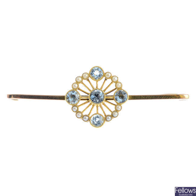 An early 20th century 9ct gold aquamarine and split pearl brooch.
