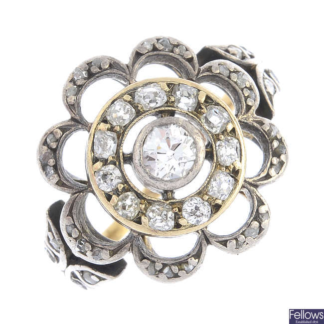 An Edwardian silver and gold diamond floral cluster ring.