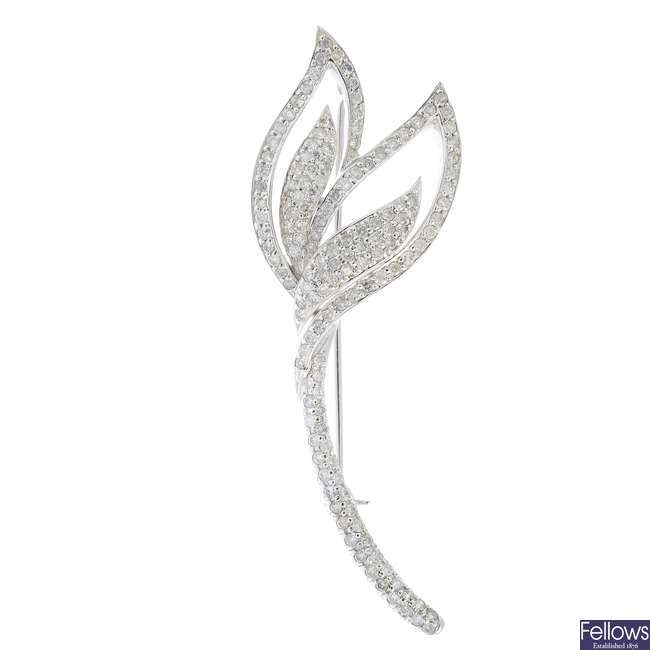 A diamond brooch.