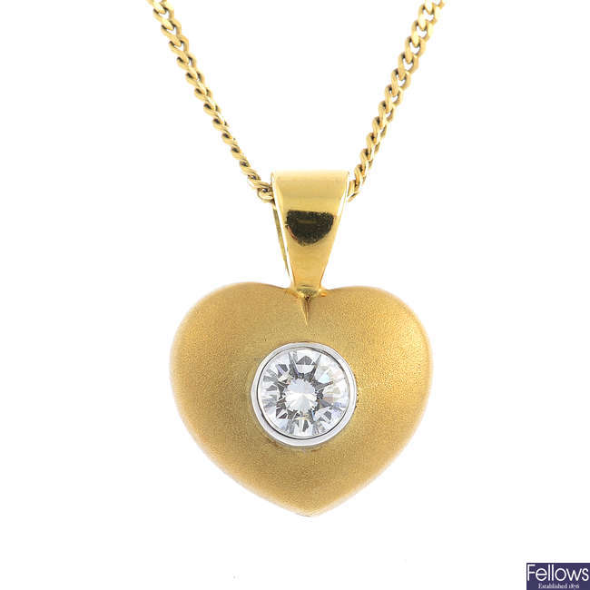 An 18ct gold diamond pendant, with an 18ct gold chain.