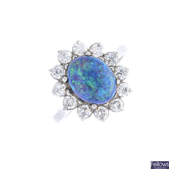 An 18ct gold black opal and diamond cluster ring.