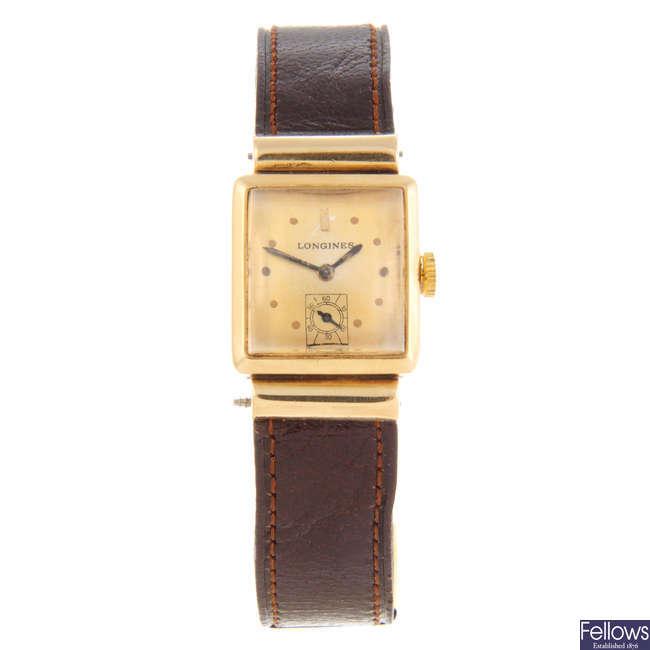 LONGINES - a lady's yellow metal wrist watch with a Longines wrist watch.