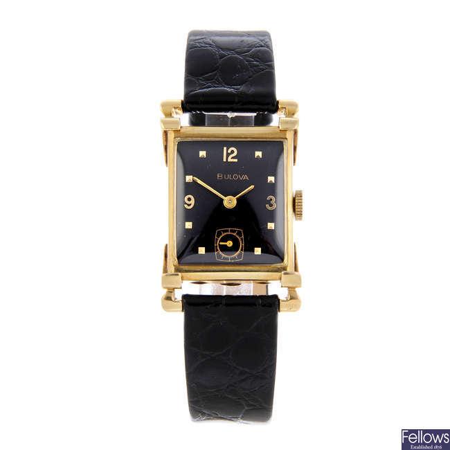 BULOVA - a lady's yellow metal wrist watch.