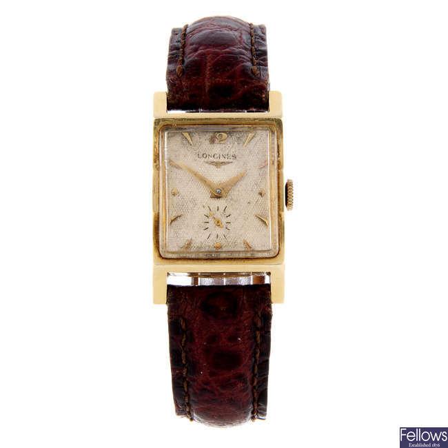 LONGINES - a gentleman's yellow metal wrist watch.