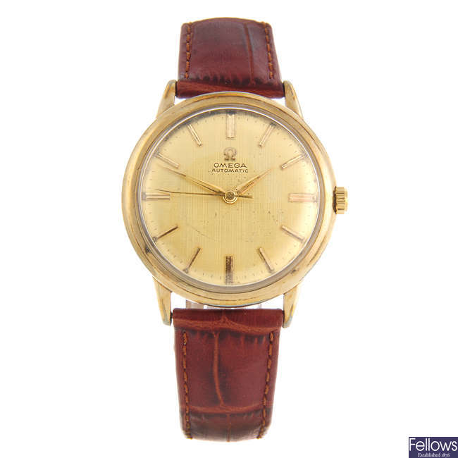 OMEGA - a gentleman's gold plated wrist watch with a gentleman's Omega wrist watch.