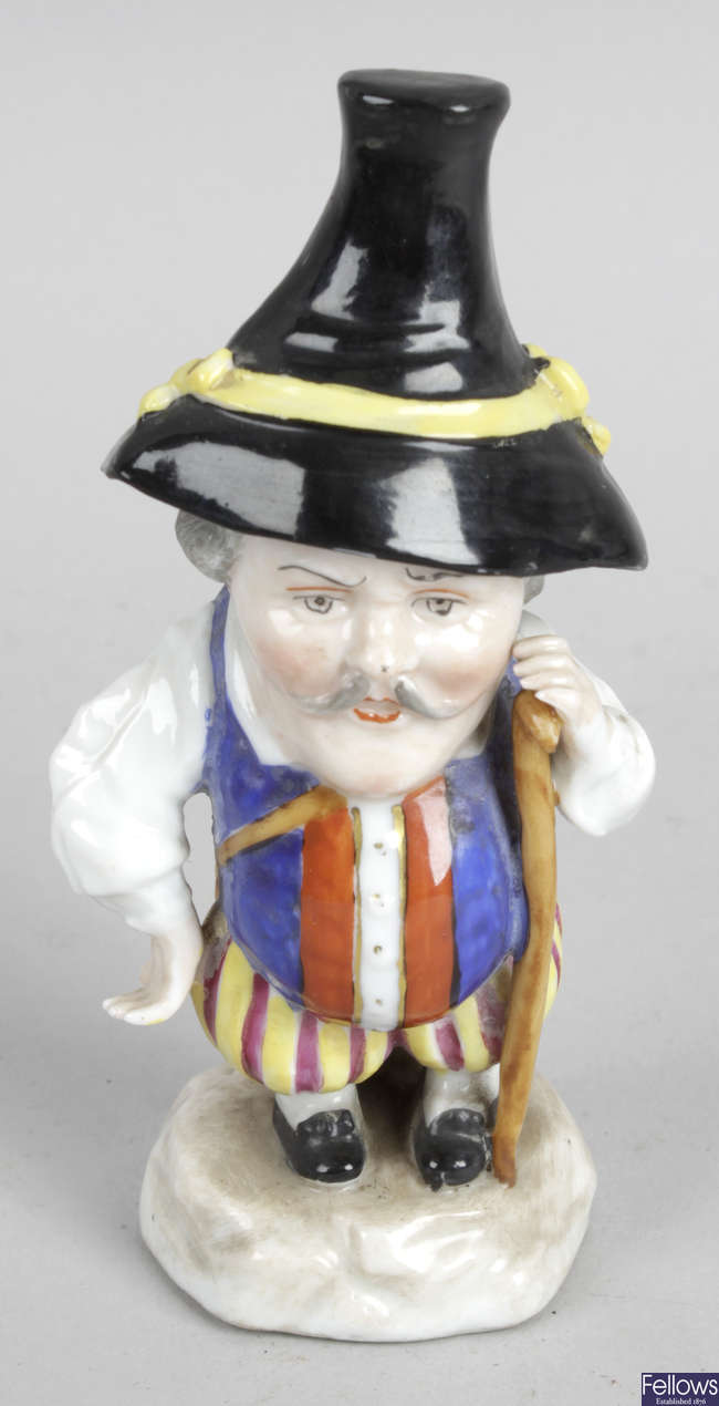 A 19th century porcelain Mansion House Dwarf figurine.