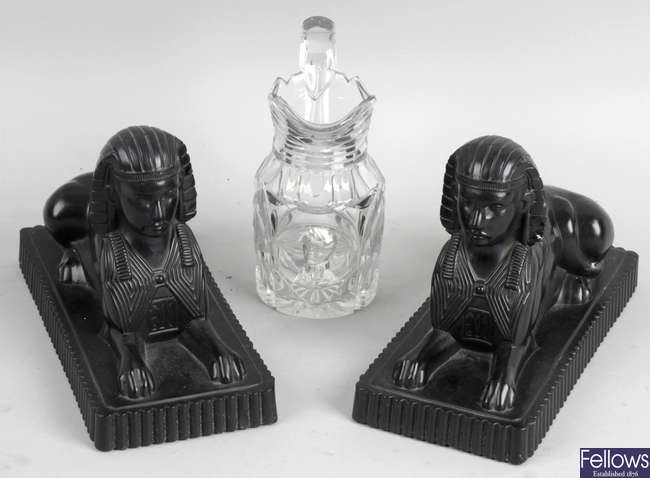A pair of Victorian Sowerby type pressed black glass bookends, together with a small 19th century cut glass jug.