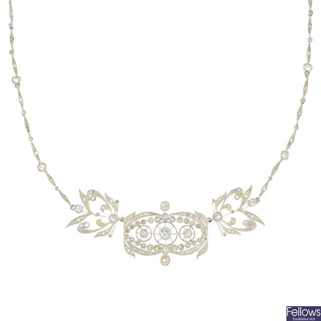 An early 20th century silver and gold diamond necklace.