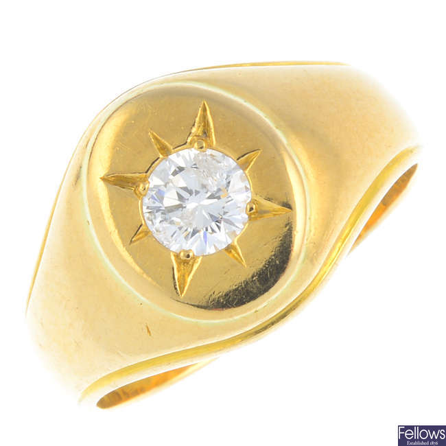 An 18ct gold diamond signet ring.