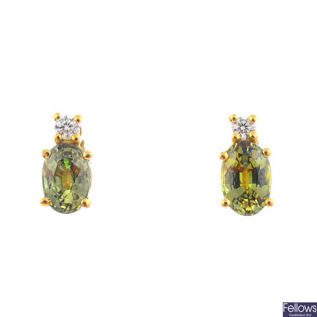 A pair of 18ct gold, green gem and diamond earrings.