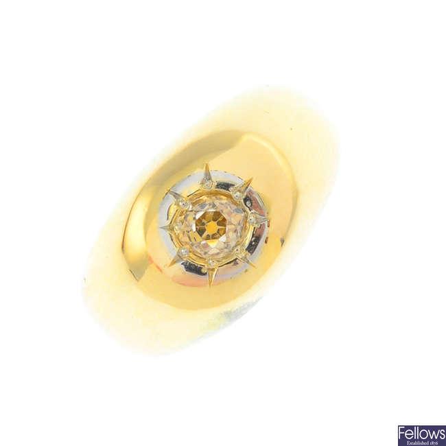 A coloured diamond single-stone signet ring.