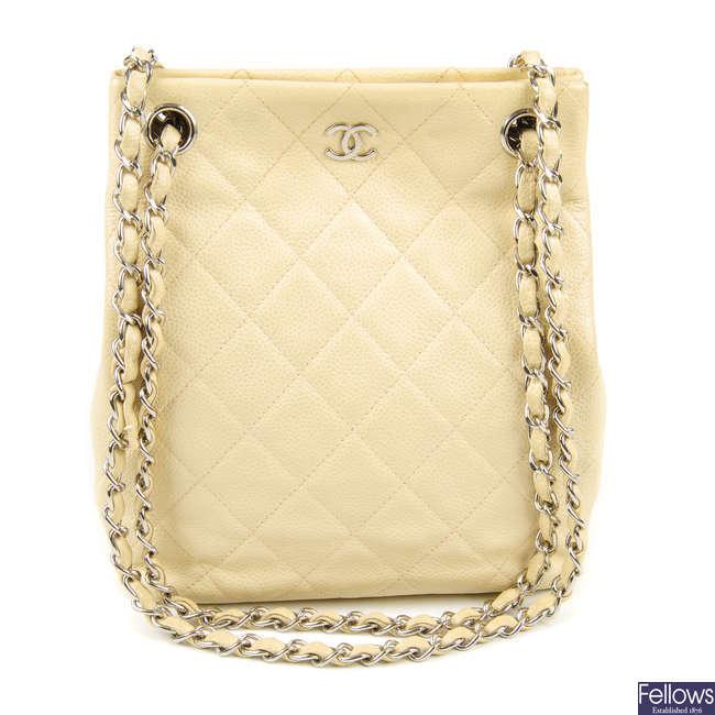 CHANEL - a small beige Caviar handbag.