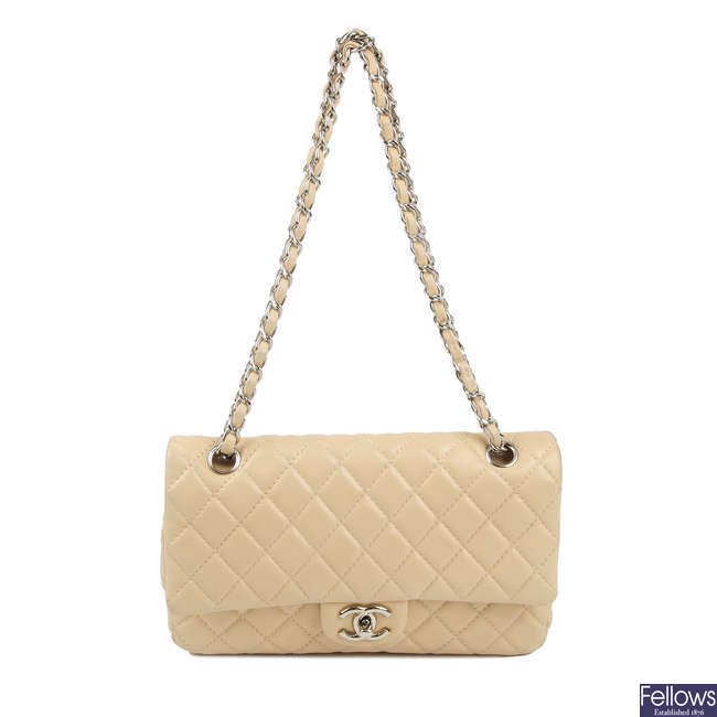 CHANEL - a cream Medium Classic Double Flap handbag.