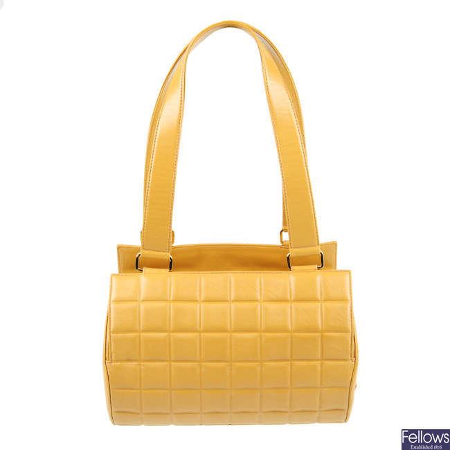 CHANEL - a beige Choco Bar barrel handbag.