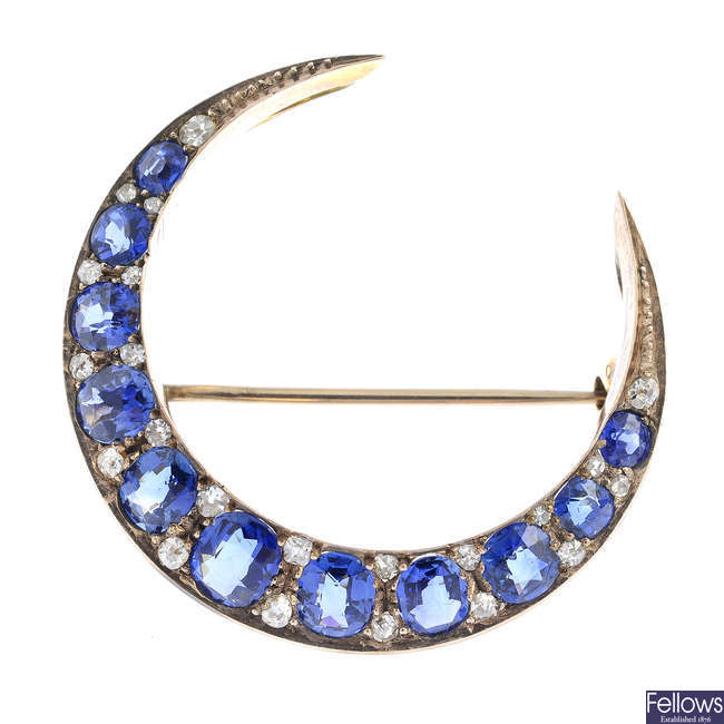 A late Victorian gold sapphire and diamond crescent brooch.