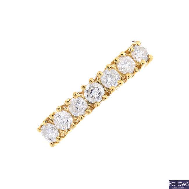 A 9ct gold diamond half eternity ring.