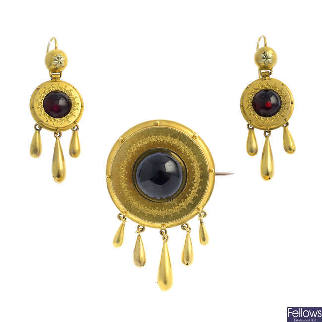 A late Victorian gold garnet brooch and earrings.