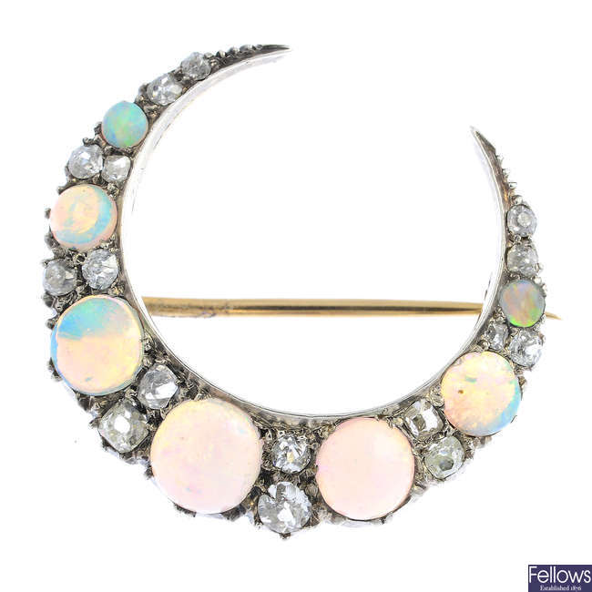 A late Victorian silver and gold opal and diamond crescent brooch.