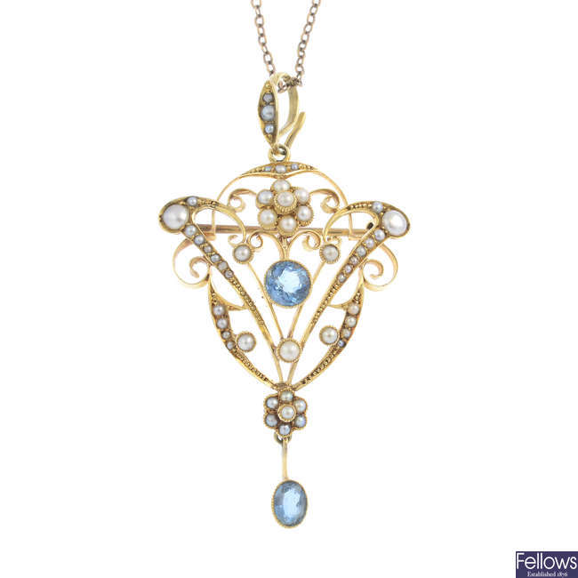 An early 20th century gold aquamarine and split pearl pendant, with chain.