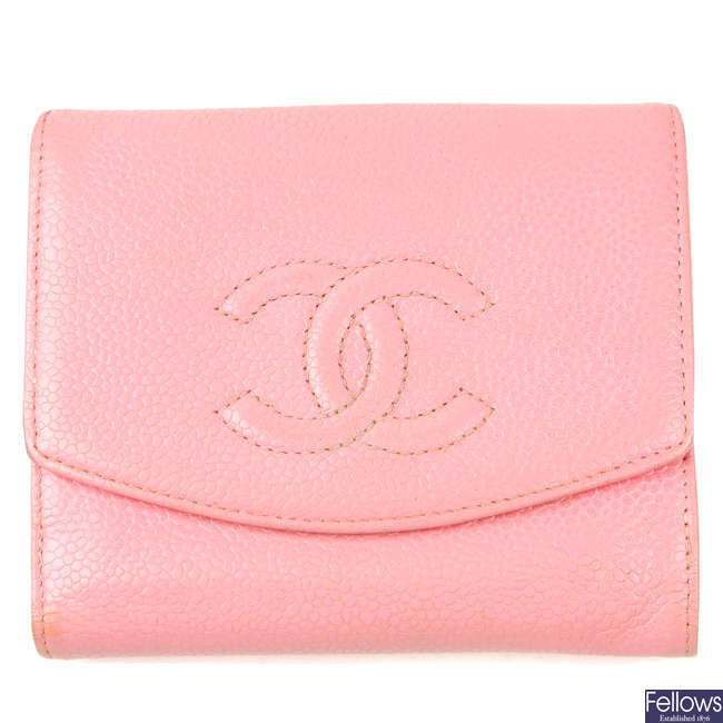 CHANEL - a pink square Caviar wallet.