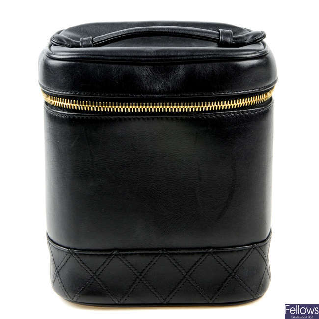 CHANEL - a leather vanity case.