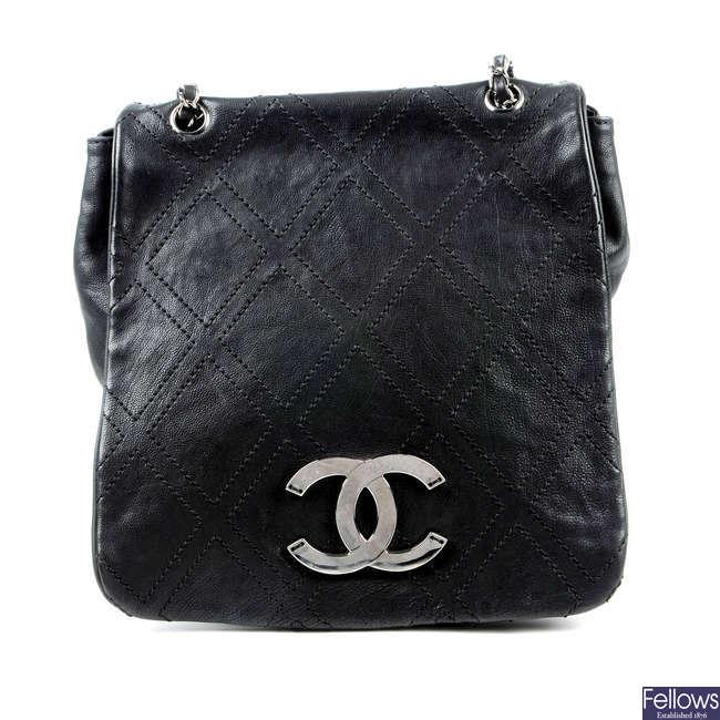 CHANEL - a black full flap crossbody handbag.